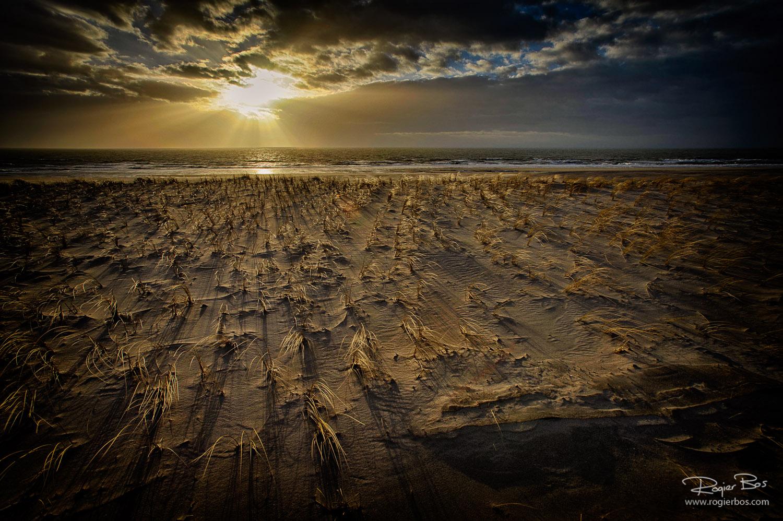 Maaadvlakte ondergaande zon